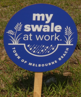 """Blue """"my swale at work."""" sign for Town of Melbourne Beach"""